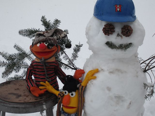 Ernie and Bert with their snowman